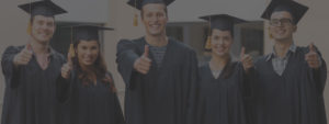 Graduates Giving Thumbs-up Stock Photo